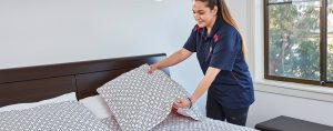 Cleaning a bed in Sydney