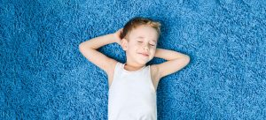 Kid resting on a clean rug